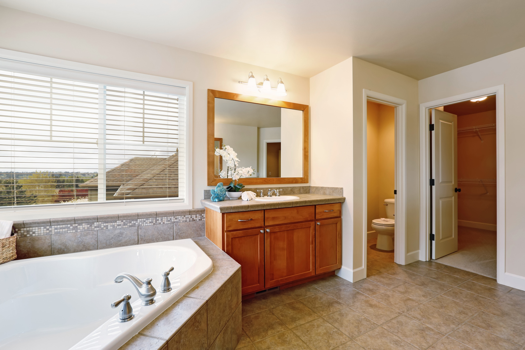 Gorgeous spa like bathroom with two vanity cabinets.